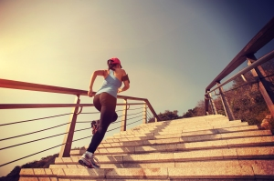 young woman runner running up on stone stairs sunrise seaside ** Note: Soft Focus at 100%, best at smaller sizes